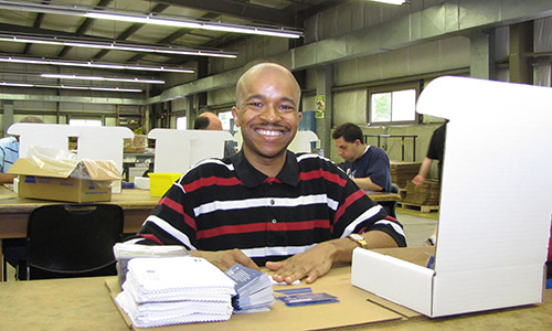 img-Jeffrey-working-and-smiling-in-workshop